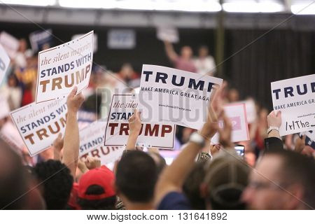 ANAHEIM CALIFORNIA, May 25, 2016: Thousands of Supporters and Fans wave signs and take cell phone pictures of Republican Nominee Presidential candidate Donald Trump as he speaks at his campaign event