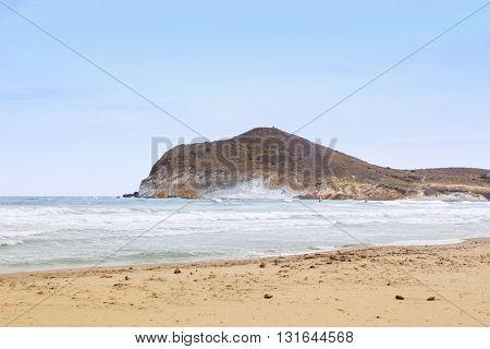 Windsurfing on the bay at Playa de los Genoveses, San Jose, Almeria Province, Spain
