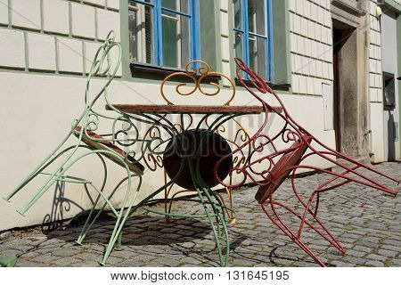 colored decorative metal chairs in the garden