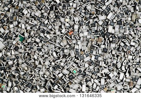 Electronic components in bulk. Texture of chip resistors.