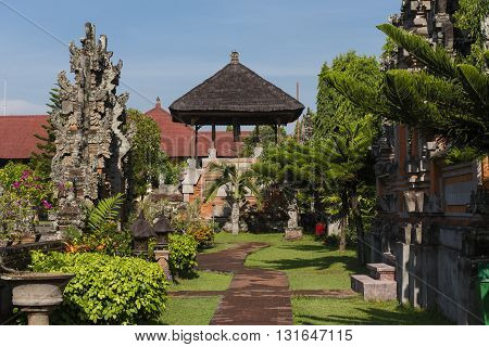 A pathway leading through a garden at the Royal Courts of Justice in Indonesia