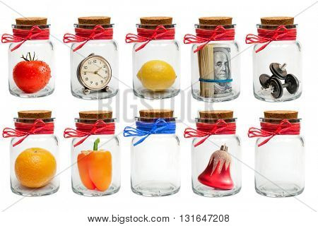 Collection of different glass jars with lids and colored twine isolated on white background
