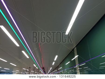 Perspective of ceiling lights at subway station