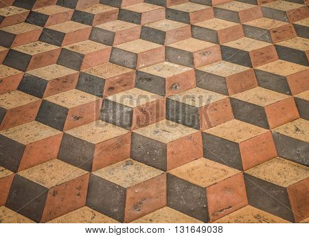 3D effect in geometrical stone mosaic design in marble church floor