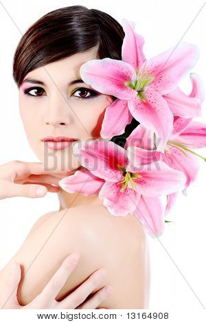 Shot of a young beautiful woman with a lily flowers. Isolated over white background.