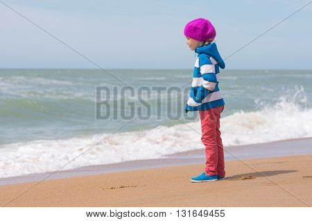Girl Standing On Sea Beach And Looking Into The Distance