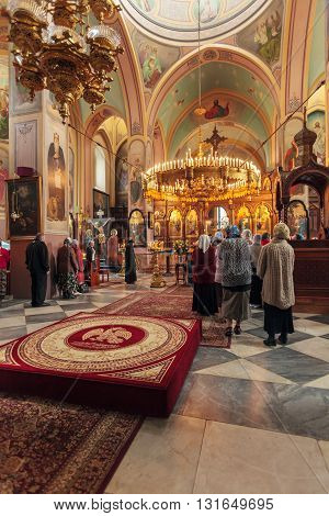 Jerusalem, Israel - February 15, 2013: Christians Taking Part In Eucharist. Saint Trinity Cathedral.