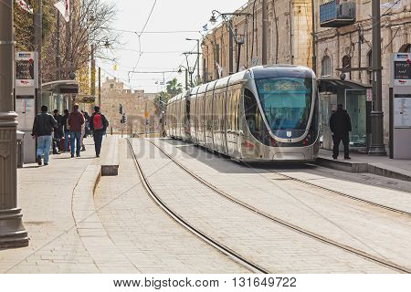 Jerusalem, Israel - February 15, 2013: People Using Modern Rapid Tram I