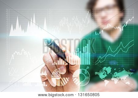 Young fund manager drawing abstarct business chart with marker on light grey background