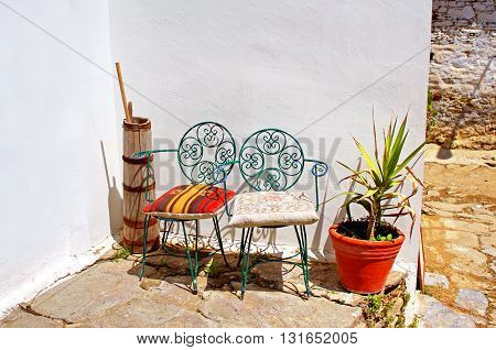 Chairs with pillows decorated with asian ornament in Turkey