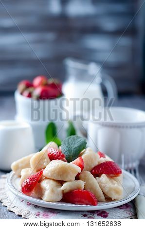 Summer dessert lazy dumplings with cottage cheese and strawberries
