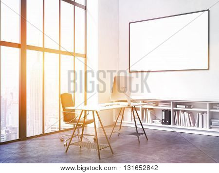 Office interior with workplace blank picture frame on wall bookshelves and window with city view. Toned image. Mock up 3D Rendering