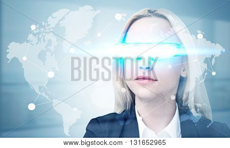 Global networking concept with network on map and businesswoman wearing illuminated smart glass