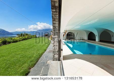 Luxury villa with indoor swimming pool, green garden