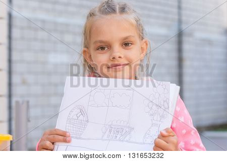A Girl Shows A Drawing, Drawn In Pencil