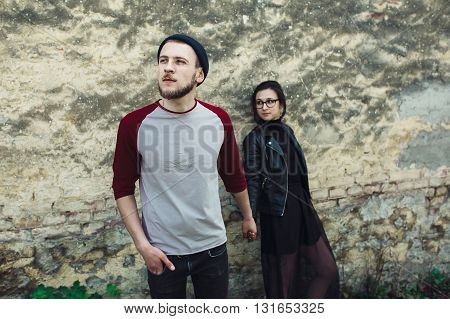 couple posing on a background of the old wall
