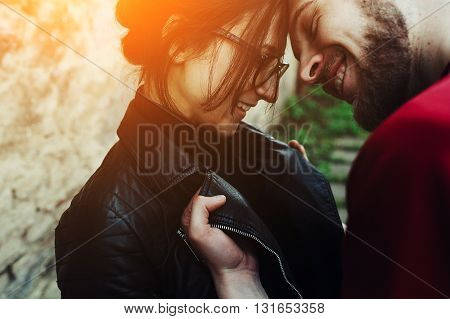 young beautiful couple fooling around on the background wall