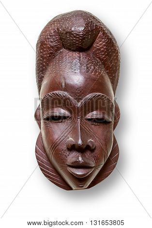 A tribal mask from Africa silhouetted on white with clipping path.