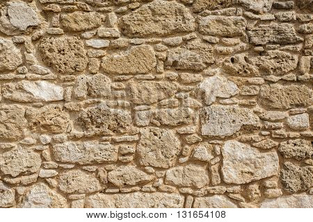 the Antique natural stonewall background close up