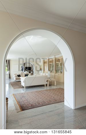 living room in luxury house, view from the corridor