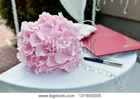 Beautiful wedding colorful bouquet for bride. Beauty of colored flowers. Close-up bunch of florets. Bridal accessories. Female decoration for girl. Details for marriage and for married couple