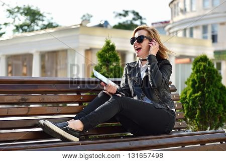 happy hipster girl with tablet listening to music