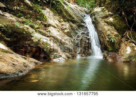 Jungle trekking on tropical island Koh Phangan in Thailand. Phaeng waterfall.