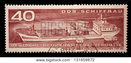 ZAGREB, CROATIA - SEPTEMBER 09: A stamp printed in GDR from the GDR Ship Building issue shows Container Cargo Ship Type 451, circa 1971, on September 09, 2014, Zagreb, Croatia