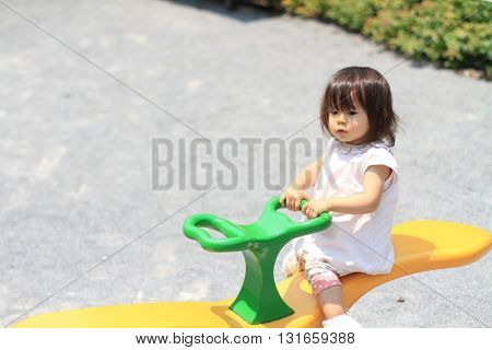 Japanese girl on the seesaw (1 year old)