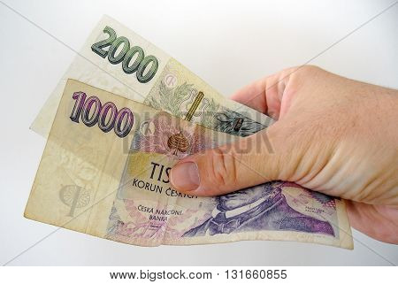 Bank-notes In White Man Hand. Pay Bills With Money. Currency Concept. Czech Crowns