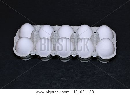 Fresh chicken eggs closeup on a black background