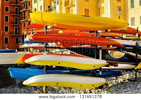 storage of colorful kayaks outdoor on seafront