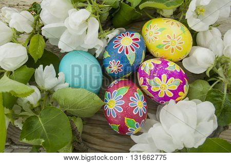 Background with Easter eggs and apple blossom
