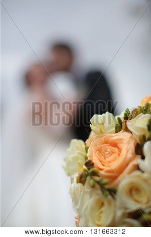 Wedding Bouquet With Kissing Couple