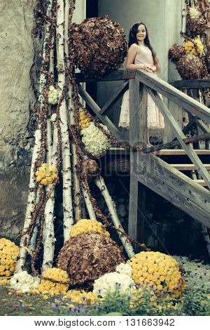Smiling Girl On Stairs With Floral Decoration