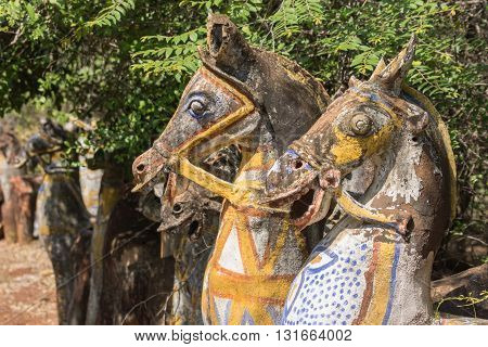 Chettinad India - October 16 2013: Ayyanar village protector Horse shrine of Namunasamudran. Two old clay horse heads are smiling. Painted bodies.