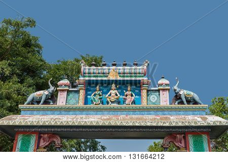 Chettinad India - October 16 2013: Ayyanar village protector Horse shrine of Namunasamudran. Entrance gate features Lord Murugan and his wives.