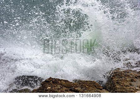 Waves crashing on the rocks of All Saints Bay in Salvador Bahia