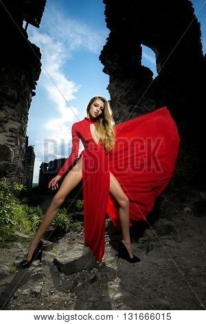 Sexy Woman In Red Dress In Ruins