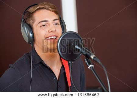 Singer Performing While Looking Away In Studio