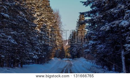 Dramatic winter road filled with snow and ice