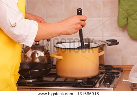 Cooking and preparing food concept. Part body of woman housewife chef in house kitchen making dinner meal.