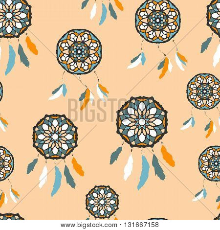 Seamless pattern with freehand dreamcatchers. Tribal vector illustration on peach background. Native american style wallpaper. Dreamcatchers with feathers
