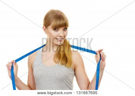 Body care diet and weight loss concept. Fitness girl sporty woman holds measure tape measuring her body isolated on white
