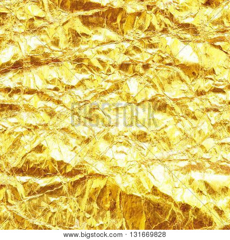 Shiny yellow leaf gold foil texture background