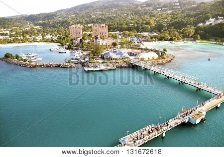 The long gangplank of path which leads from the cruise ship to the shores of Jamaica which travelers use for embarking and disembarking.