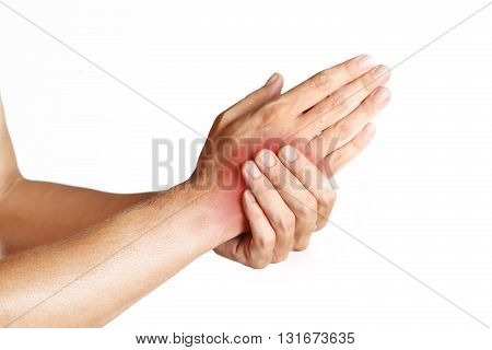 Studio shot of young man with pain in hand