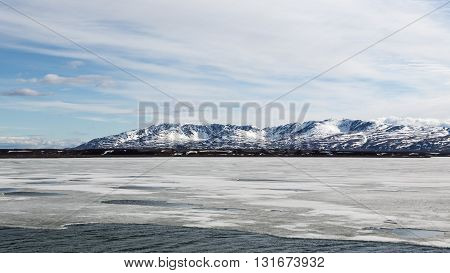 Waters flank the Alaska Range of mountains