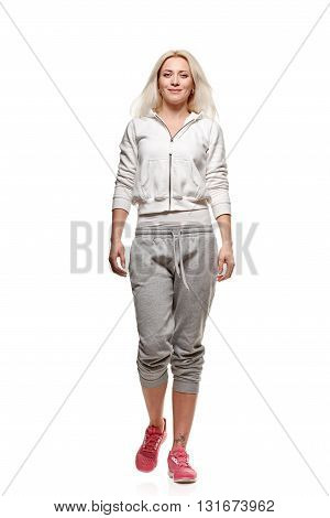 fitness and lifestyle concept, woman doing sports on white background