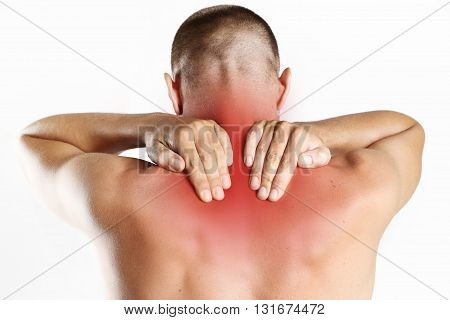 Studio shot of young man with pain in neck
